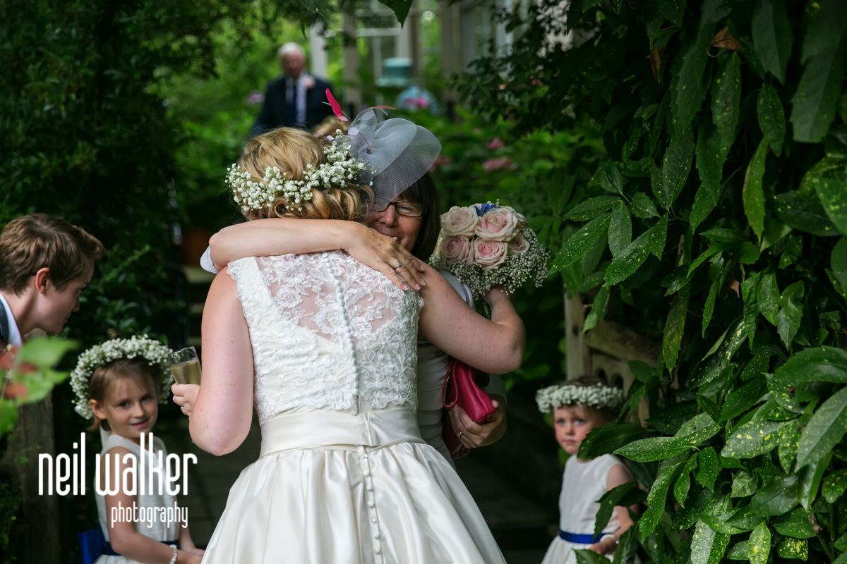 mother of the bride hugging the bride