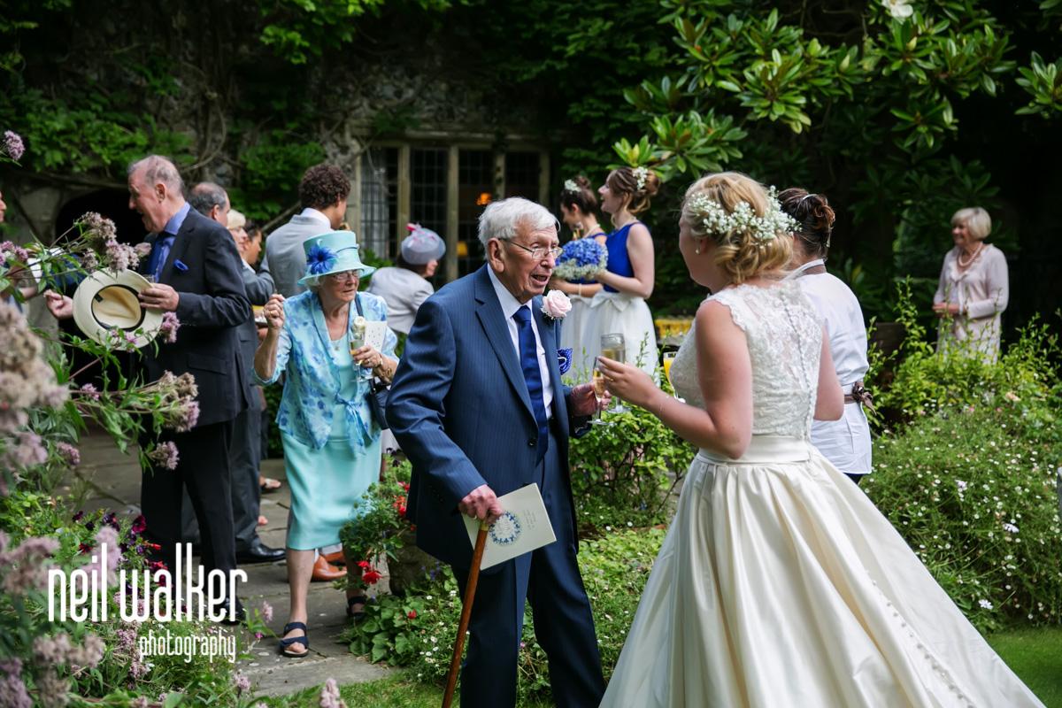 bride's grandfather congratulating bride