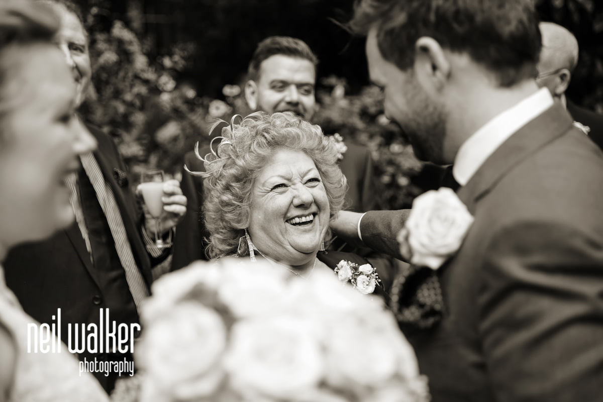 mother of the groom congratulating the groom