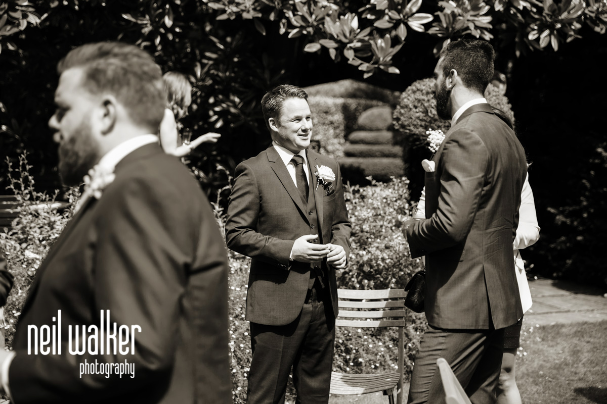 best man talking to other guests