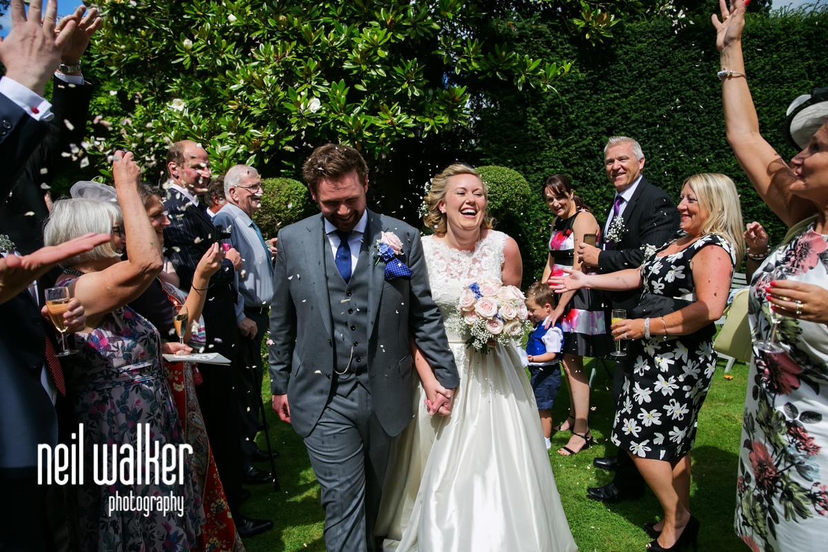 bride & groom walking through confetti
