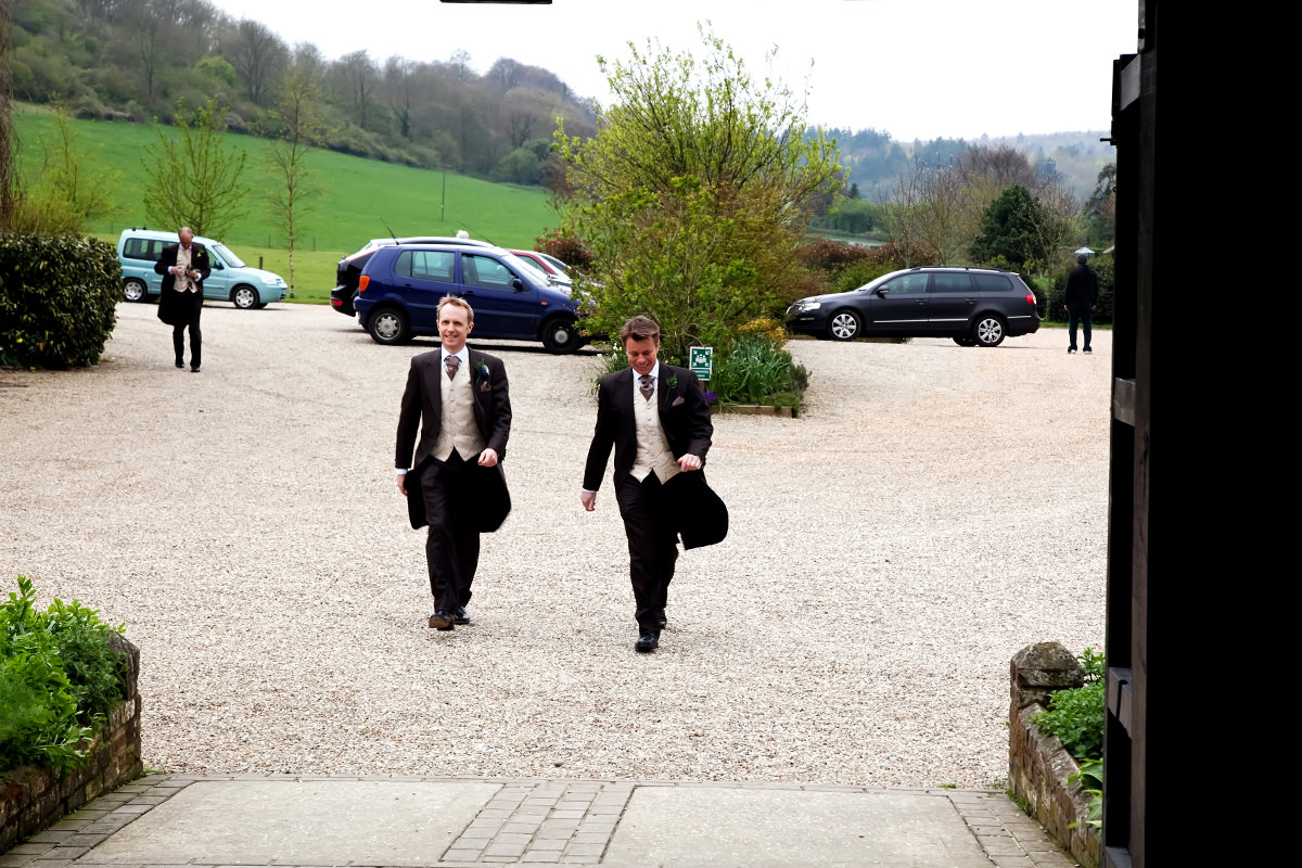 the groom arriving for his wedding at Upwaltham Barns