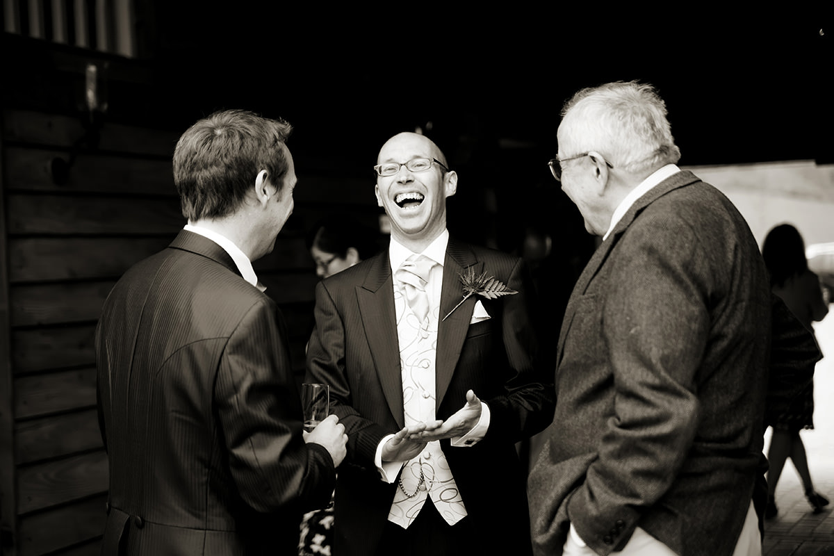 a groomsman laughing