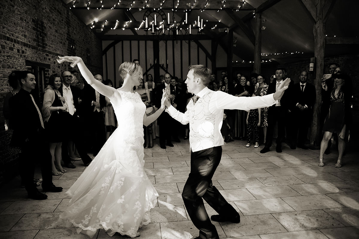 the bride & groom having their first dance at Upwaltham Barns