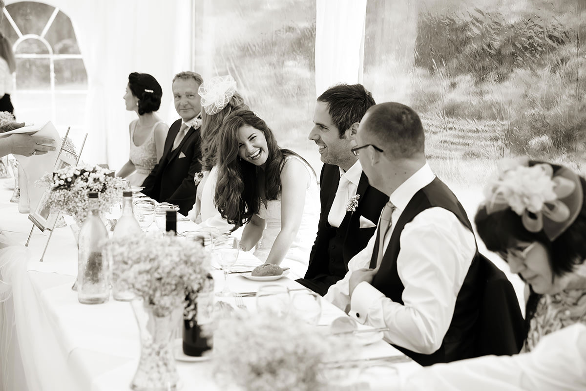 the bride laughing at her Findon Manor wedding