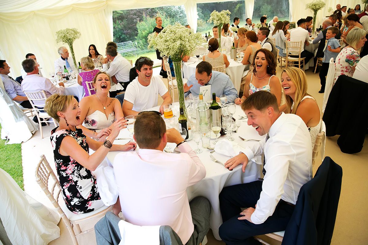 guests laughing at a Findon Manor wedding