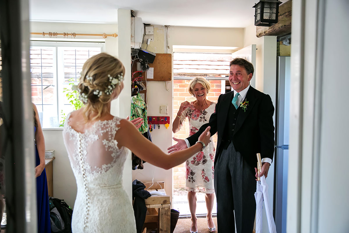 a father's joy at seeing the bride in her wedding dress