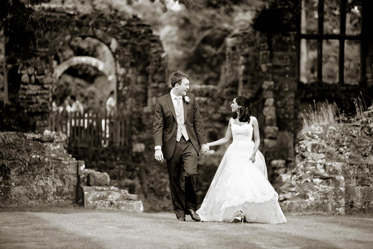 the bride & groom walking at Slaugham Place