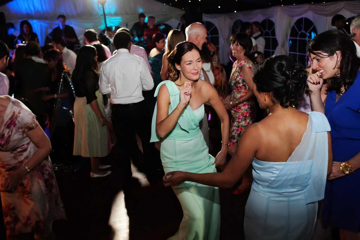 a bridesmaid dancing at a wedding at Slaugham Place