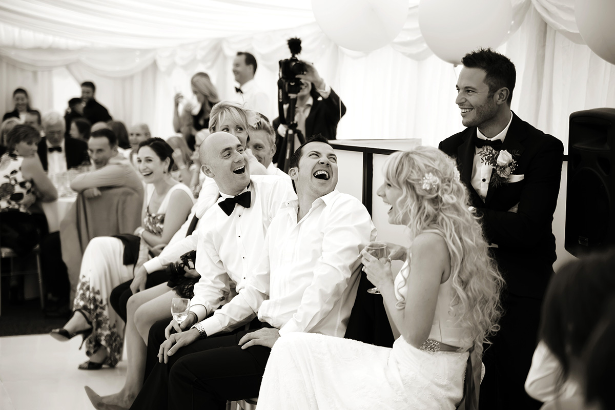 the bride & groom's reaction to the best man's speech