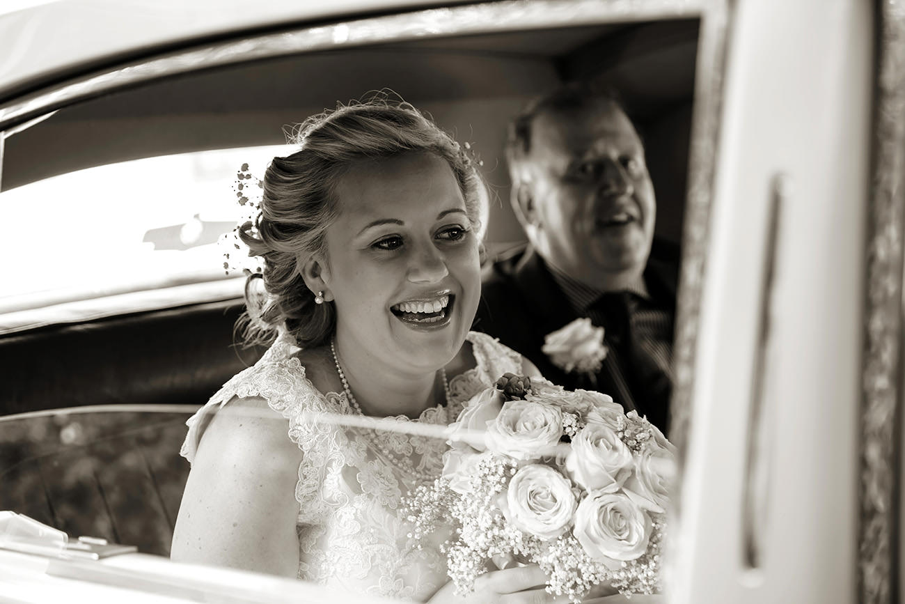 a bride arriving at her Sussex wedding in the car with her father