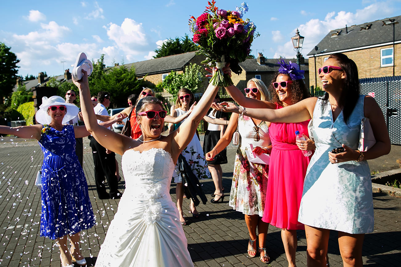 a bride cheering on her wedding day