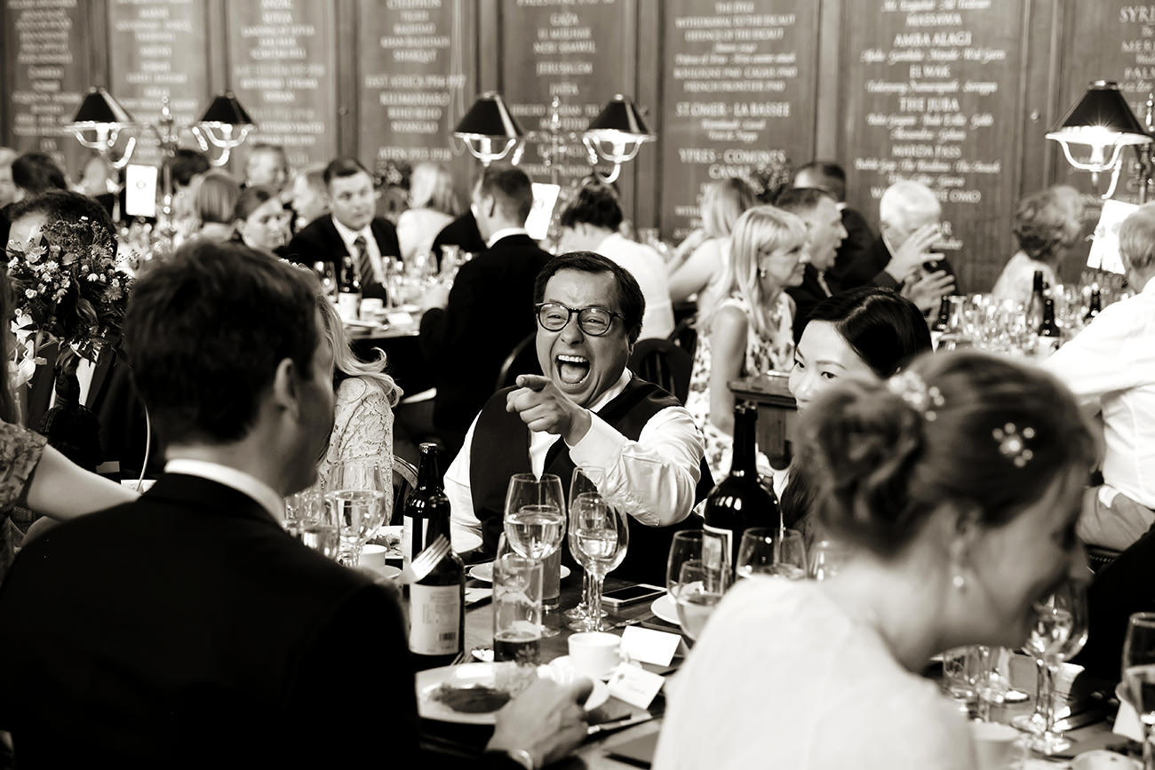a guest laughing during the wedding breakfast