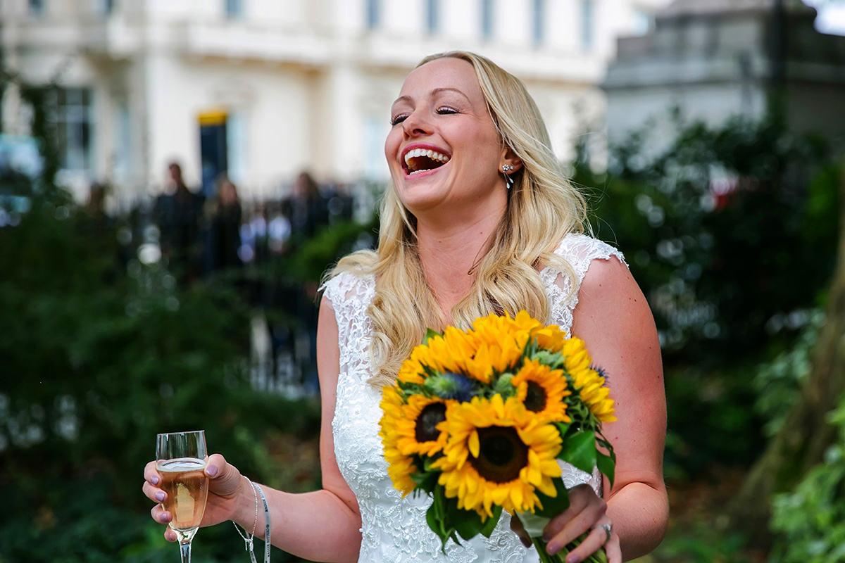 a bride laughing at an ICA wedding