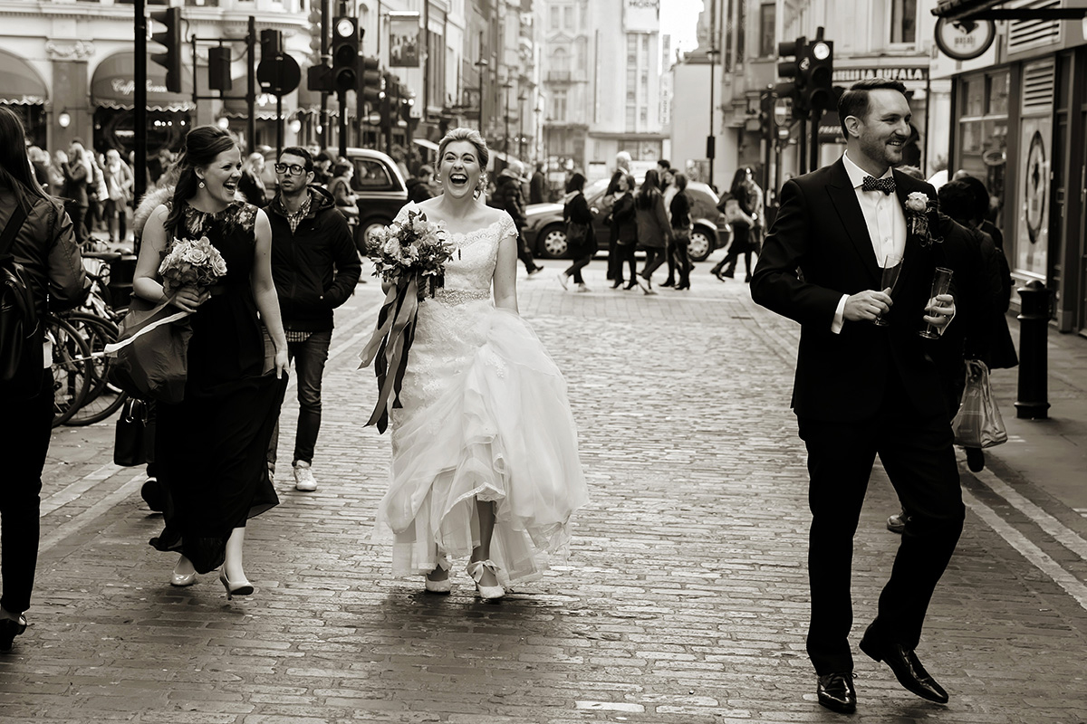 a bride walking through the streets of Soho in London