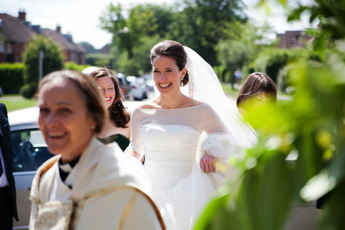 a bride arriving at the church for her wedding