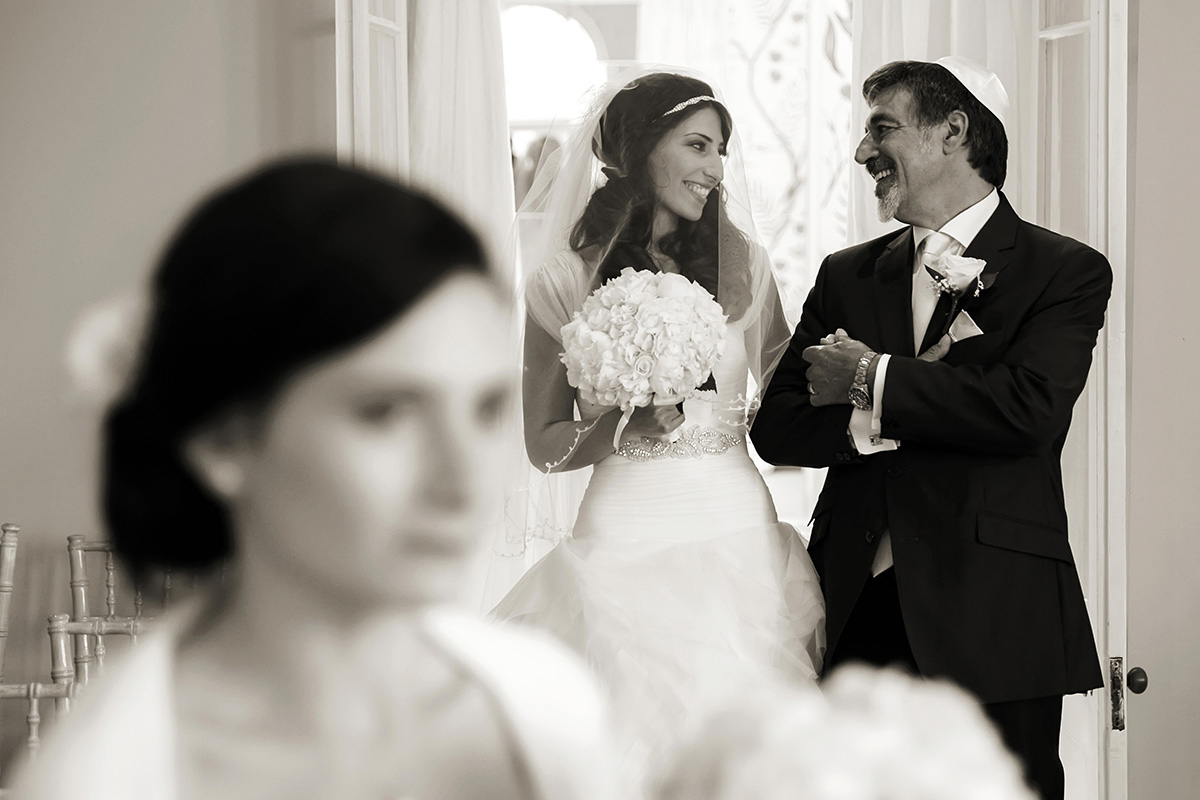 a bride & her father sharing a private moment before they start the wedding ceremony at a Jewish wedding