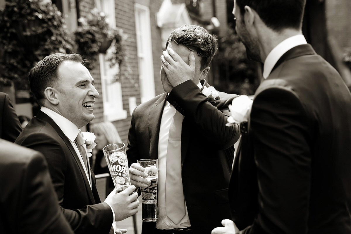guests at a wedding laughing