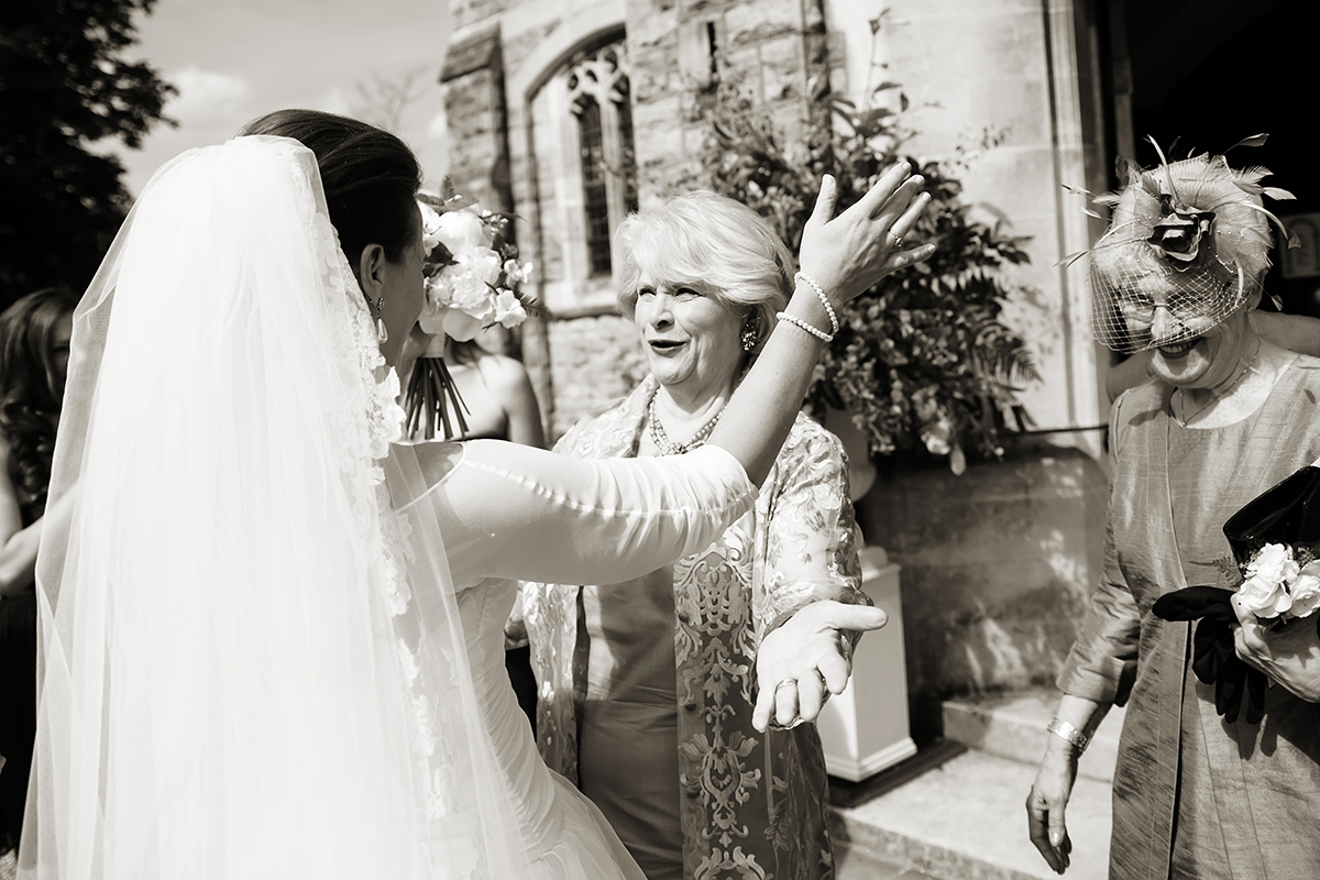 mother of the bride greeting her daughter after the wedding ceremony