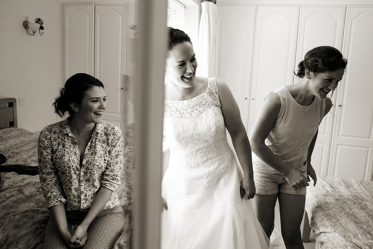 a bride & her bridesmaids getting ready for her wedding