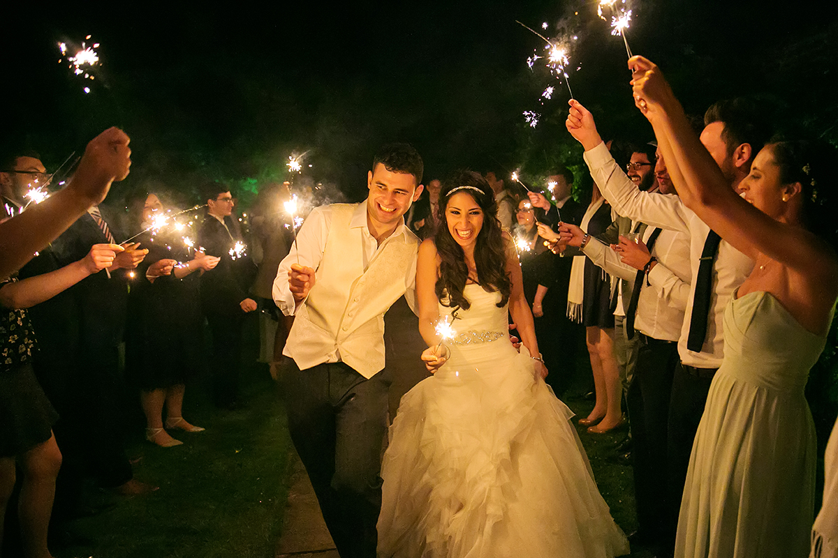 a bride & groom doing a sparkler run