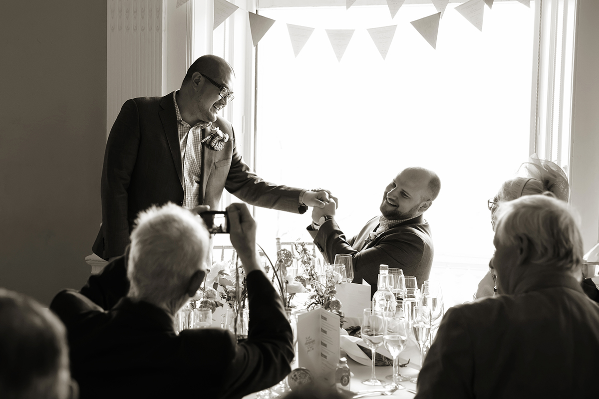 the grooms at a same sex wedding during the speeches