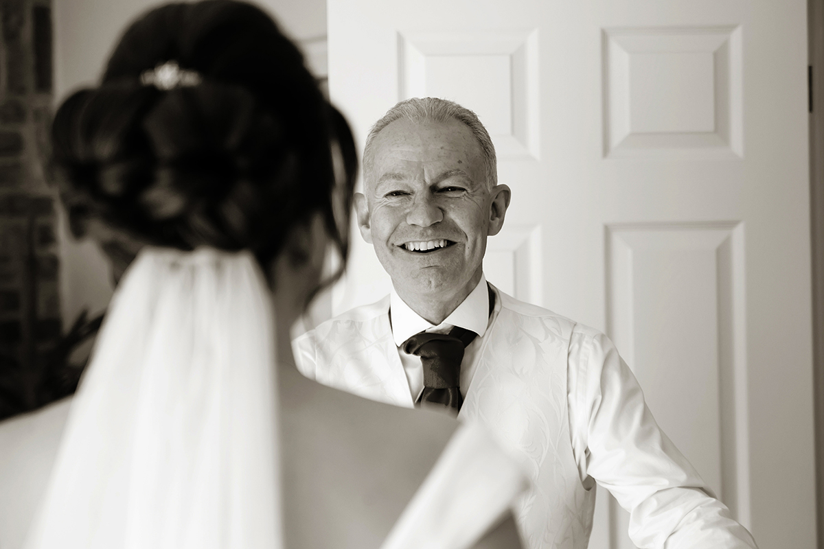 a father greeting his daughter at her wedding