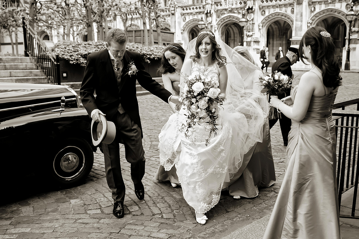 a bride arriving at the Houses of Parliament for her wedding