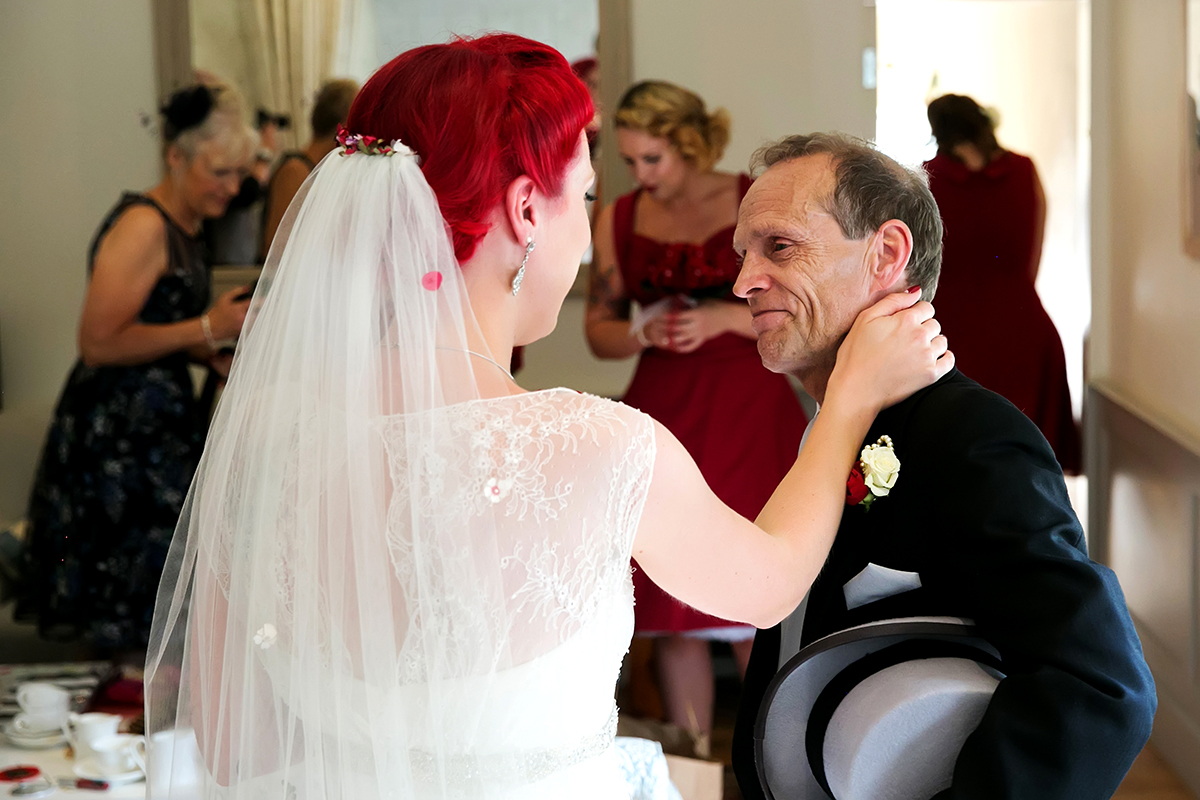 father of the bride & his daughter having an emotional moment before the wedding ceremony at a wedding in Sussex