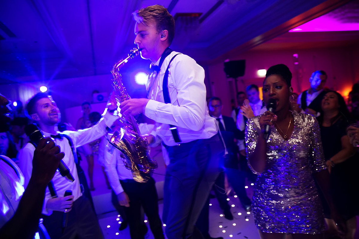 a saxophonist playing at a wedding