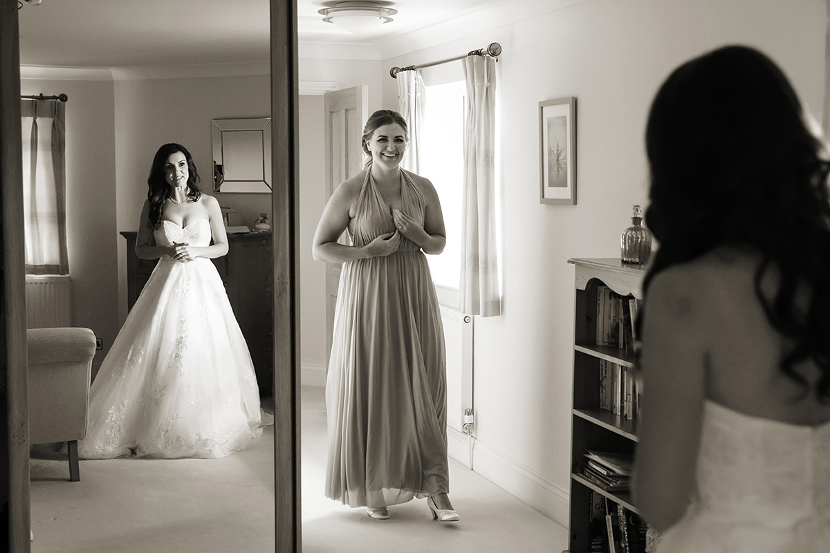 a bridesmaid getting emotional on seeing the bride in her dress for the first time