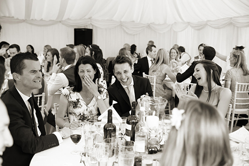guests laughing at the best man's speech at a Sussex wedding