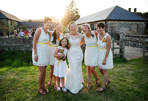 a bride & bridesmaids at Farbridge, a Sussex barn wedding venue