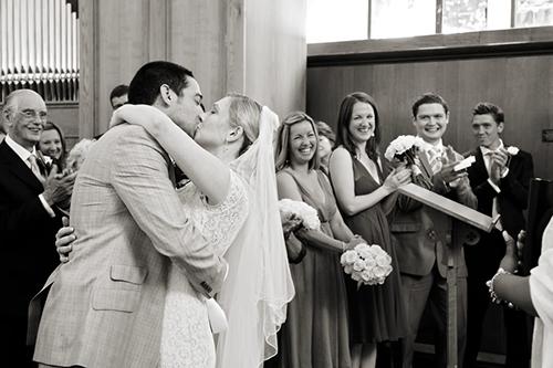 a bride & groom share their first kiss as man & wife