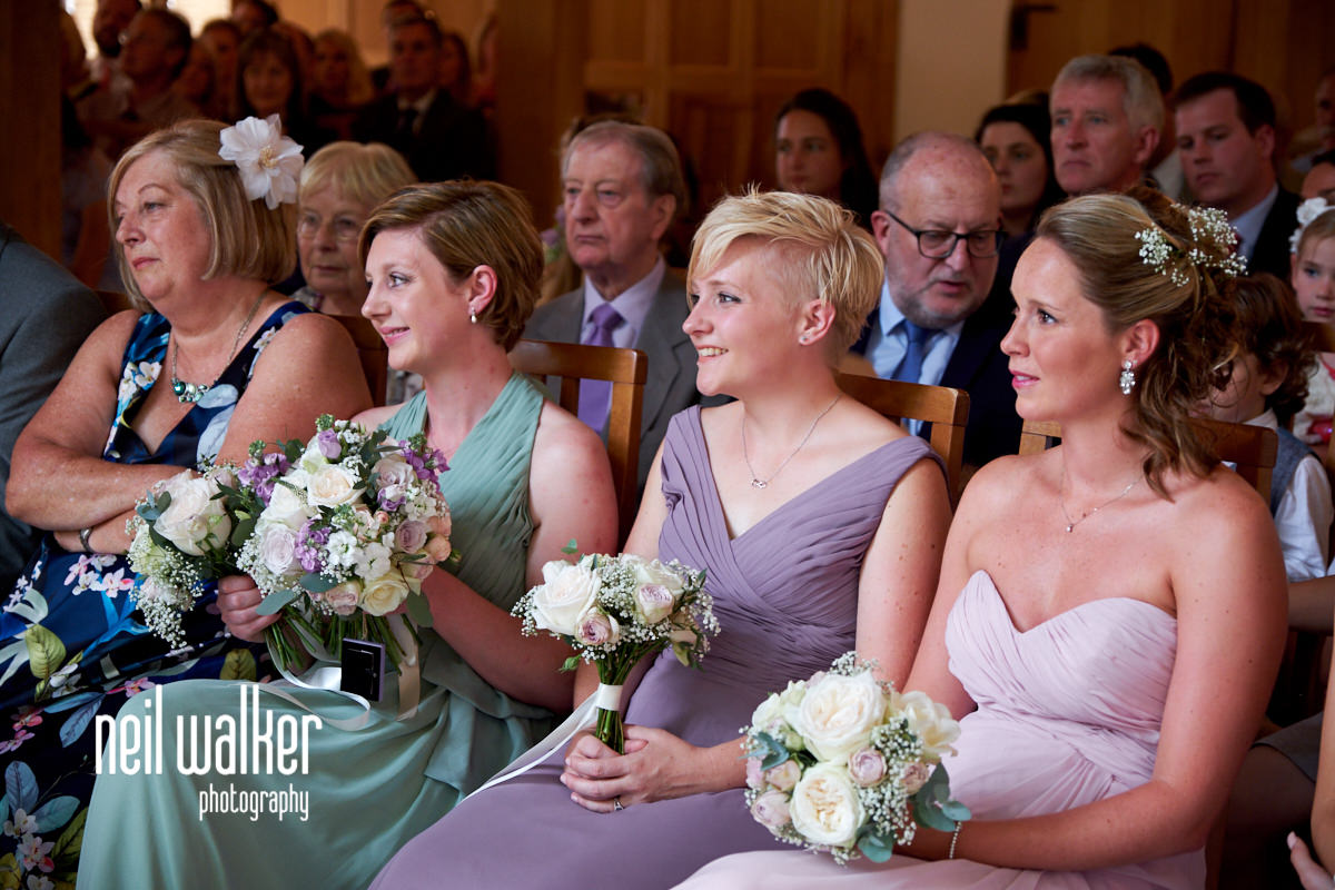 bridesmaids watching the wedding ceremony