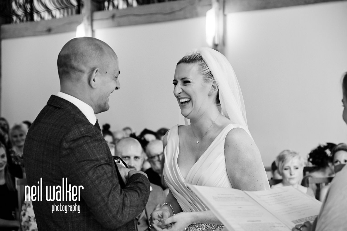 the bride & groom laughing together