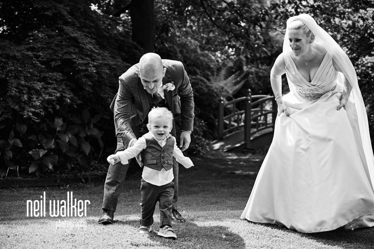 the bride & groom & their little boy laughing