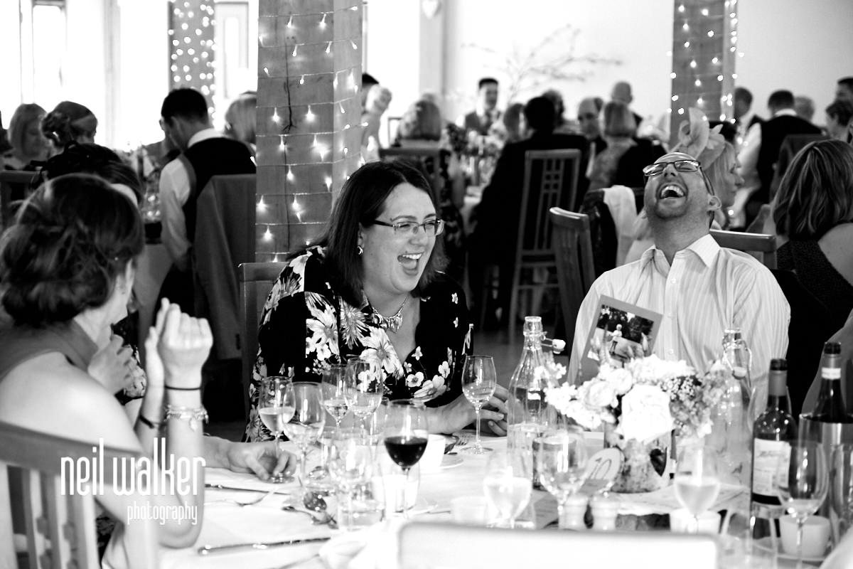 guests laughing at a joke