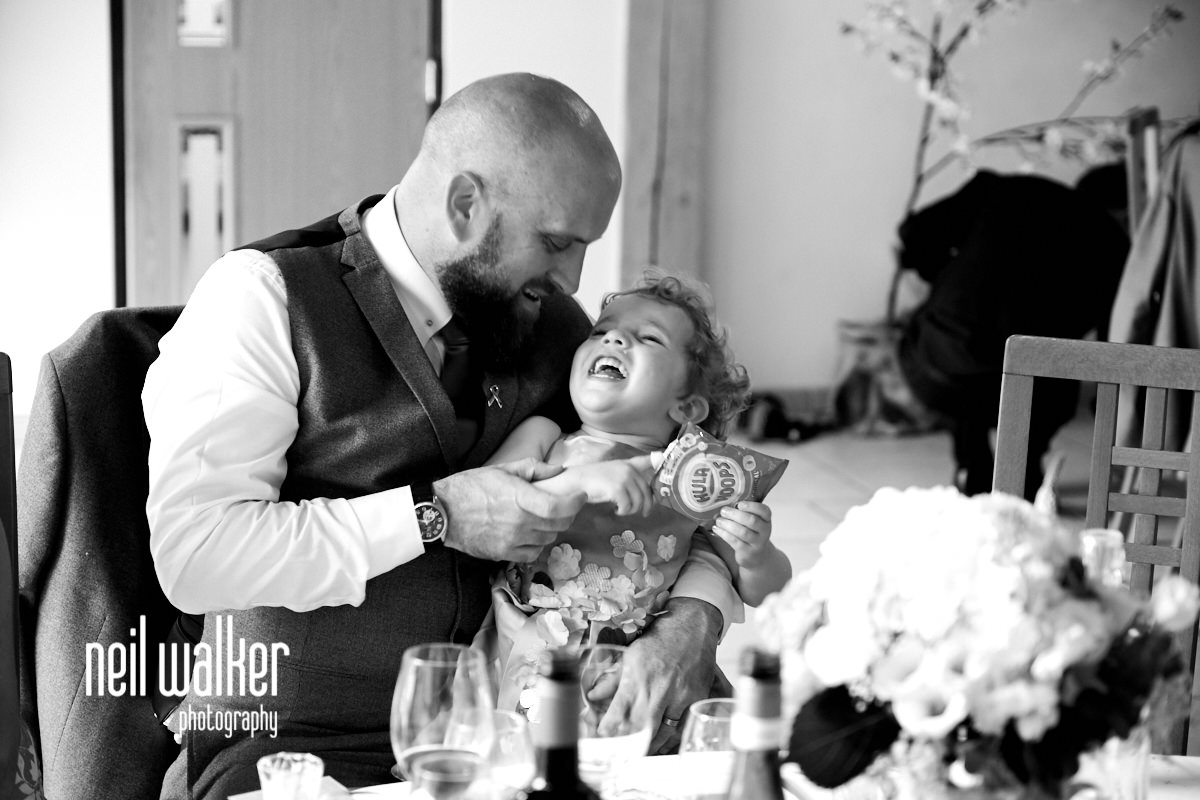 brother of the bride laughing with his daughter
