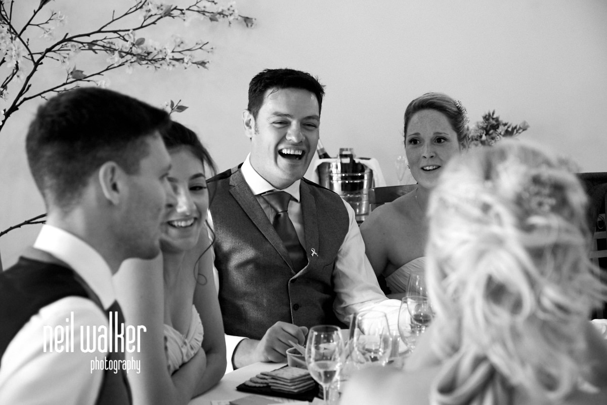 a groomsmen laughing