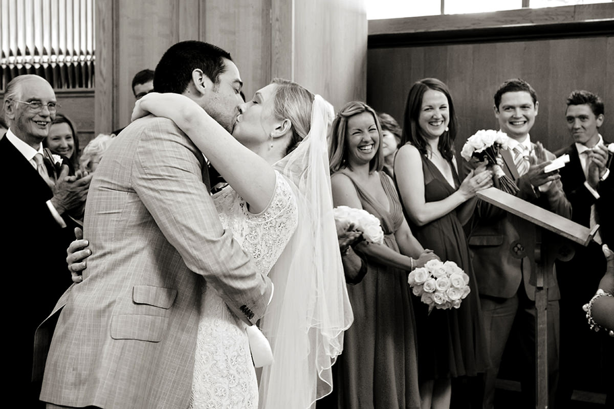 a couple's first kiss after getting married