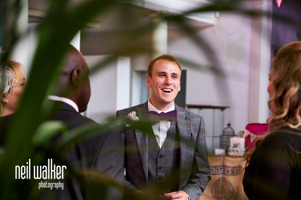 the groom laughing