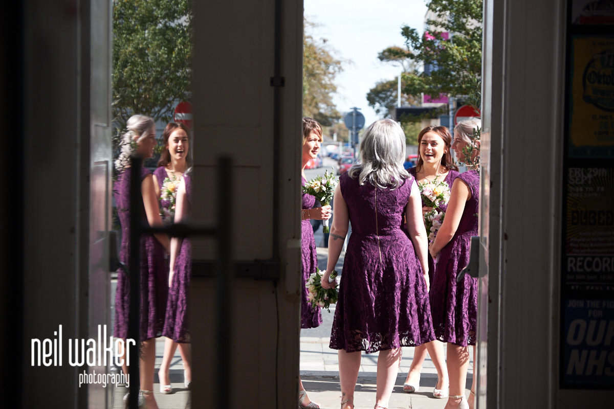 the bridesmaids waiting outside St Paul's Worthing ready to come in for the ceremony