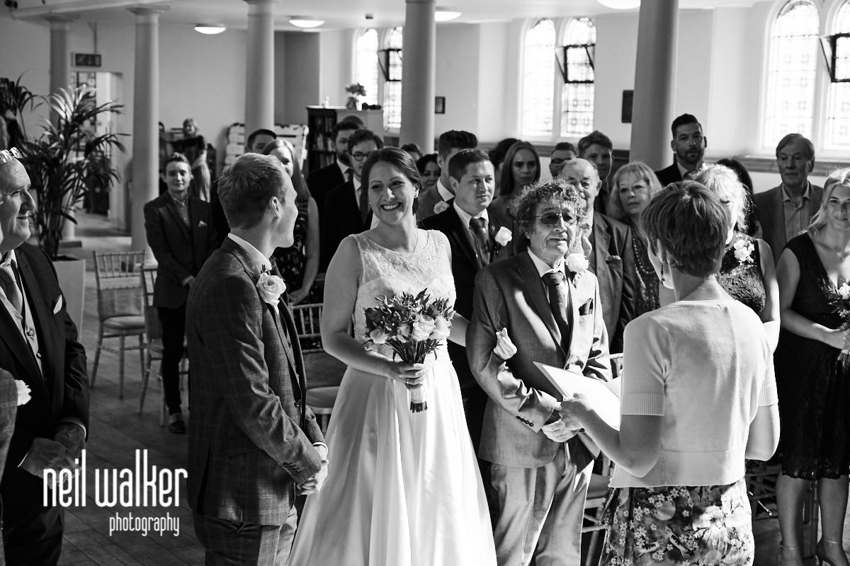 the bride looking lovingly at the groom