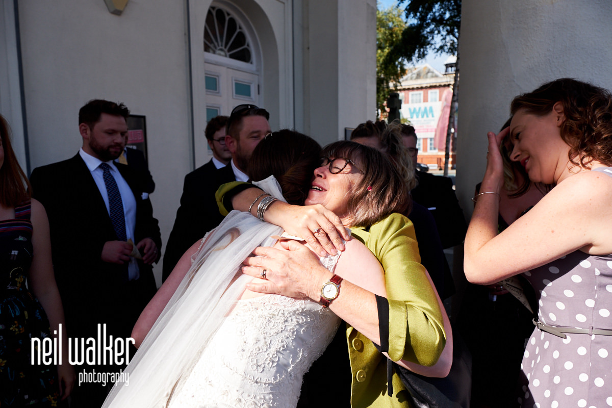 a guest hugging the bride