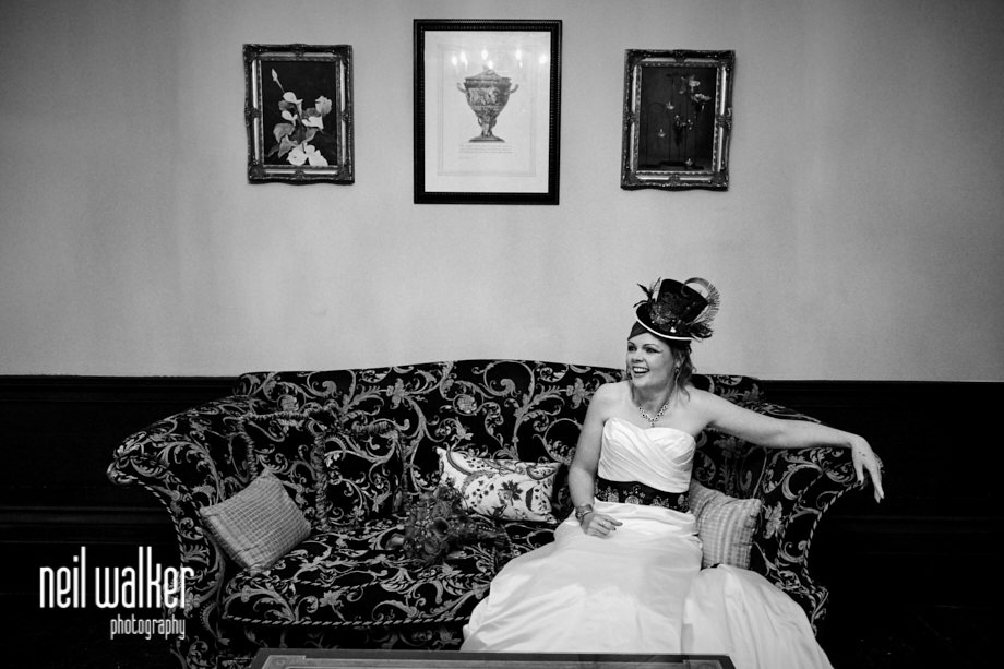 the bride on a sofa waiting for the ceremony to begin