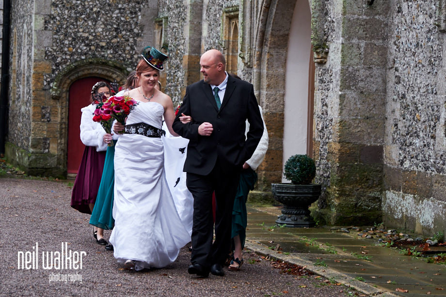 the bride and her brother on the way to the ceremony at Castle Goring