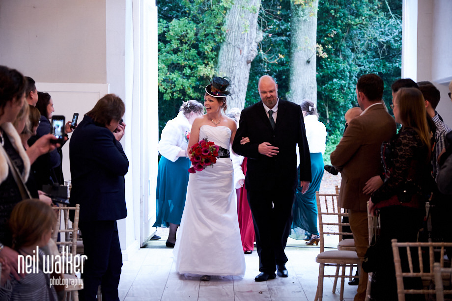 the bride walking into the Ceremonial Hall at Castle Goring for her wedding ceremony