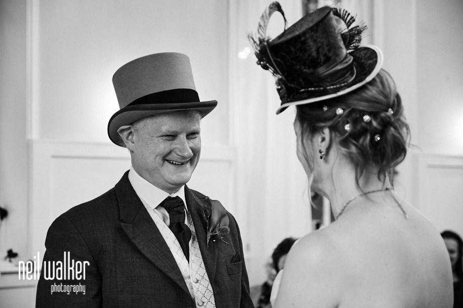 the groom smiling at the bride