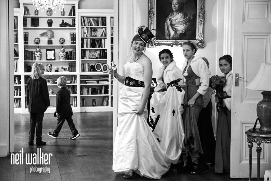 the Bride and her bridesmaids walking into the State Rooms at Castle Goring for their reception